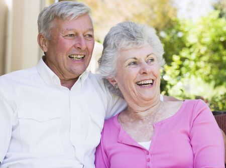 golden years series: Senior couple sitting outdoors
