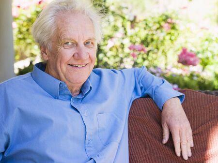 Senior man sitting outdoors photo