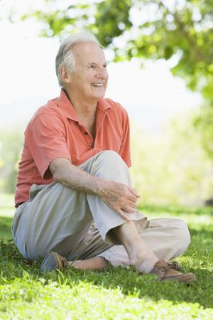 Senior man sitting outdoors photo