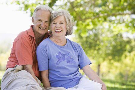 Senior couple sitting outdoors Stock Photo - 3177524