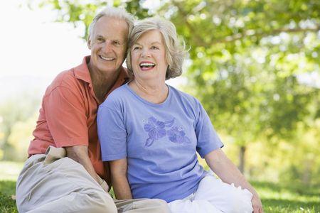 Senior couple sitting outdoors Stock Photo - 3177525