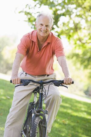 Senior man on a bicycle photo