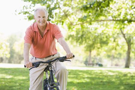 one senior man only: Senior man on a bicycle