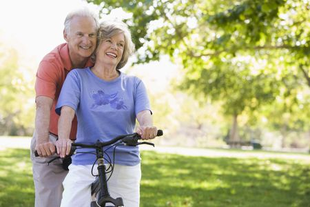 Senior couple on a bicycle photo