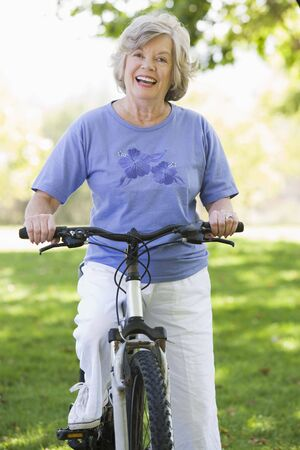 Senior woman on a bicycle photo