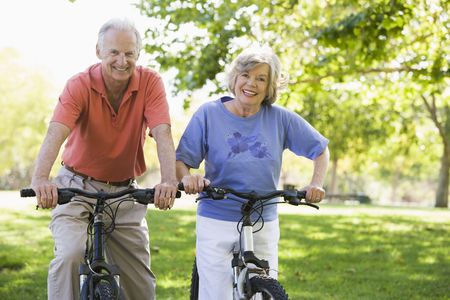 male senior adult: Senior couple on bicycles
