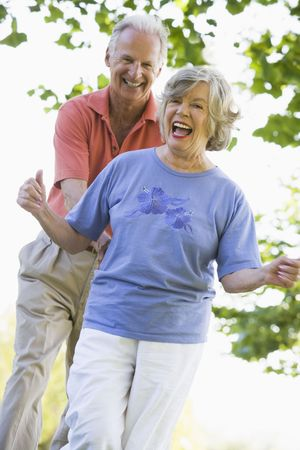 offset views: Senior couple walking in park together