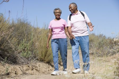 Senior couple on a walking trail photo