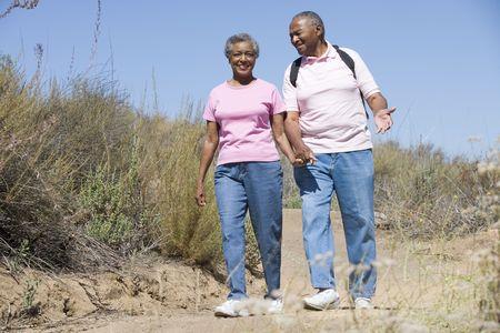 knap sacks: Senior couple on a walking trail