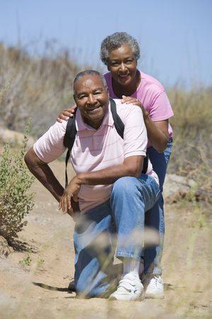 looking towards camera: Senior couple on a walking trail