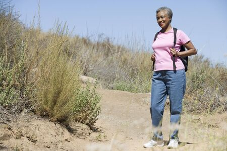 Senior woman on a walking trail Stock Photo - 3177538