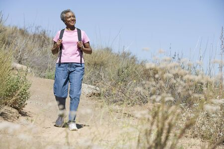 Senior woman on a walking trail Stock Photo - 3177563