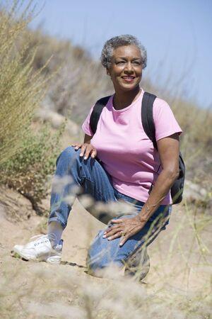 knap sack: Senior woman on a walking trail Stock Photo