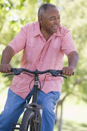 aging american: Senior man on a bicycle