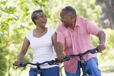 Senior couple on bicycles photo