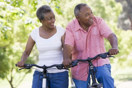 aging american: Senior couple on bicycles