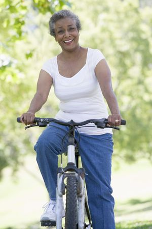 aging american: Senior woman on a bicycle