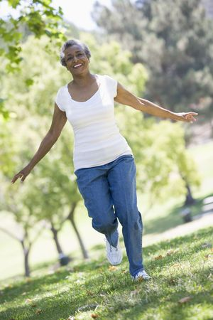 staying fit: Senior woman walking in park Stock Photo