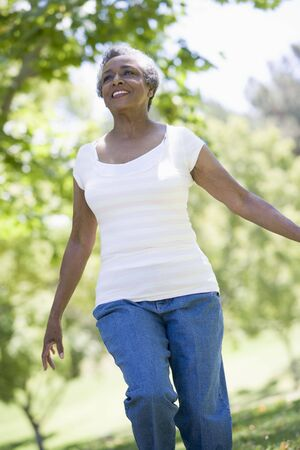 golden years series: Senior woman walking in park Stock Photo