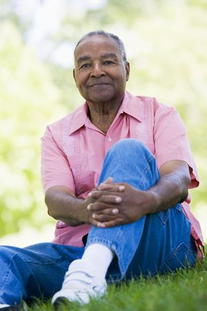 Senior man sitting outdoors Stock Photo - 3177004
