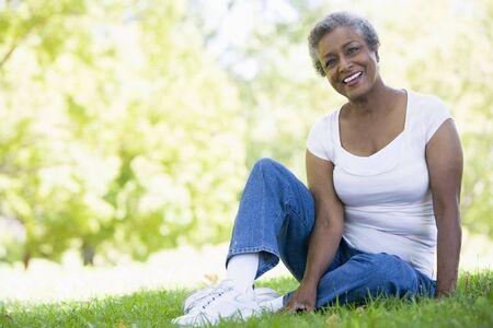 one senior adult woman: Senior mujer descansando en un parque  Foto de archivo
