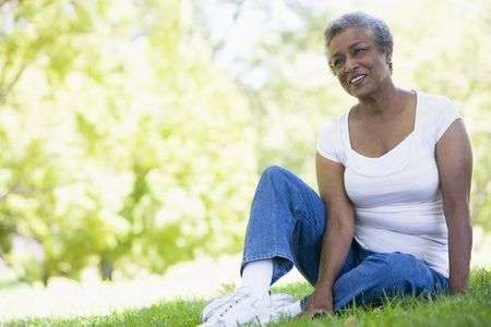Senior woman resting in a park photo