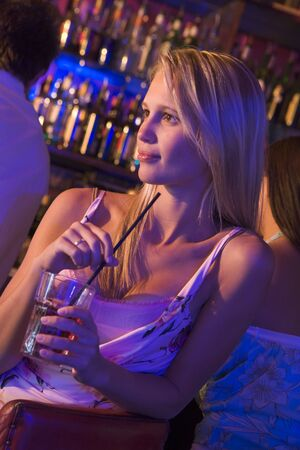 gels: Young woman in a bar Stock Photo