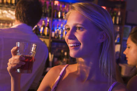 Young woman in a bar with friends photo