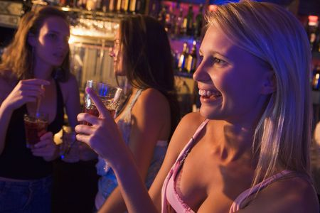 colored gels: Young woman in a bar with friends