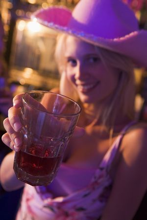 colored gels: Young woman in a bar Stock Photo