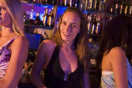 Young woman in a bar with friends Stock Photo - 3206793
