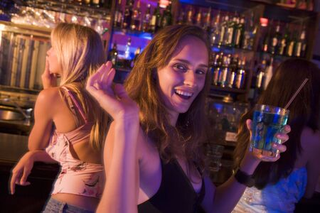 night club series: Young woman in a bar with friends