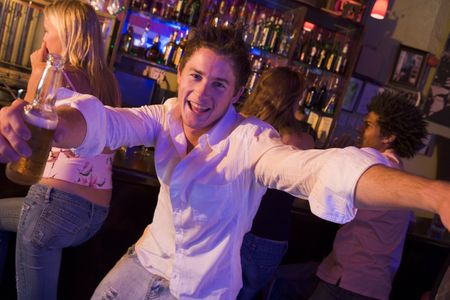 only teenage girls: Young man in a bar Stock Photo