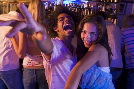 Young people dancing in a bar photo
