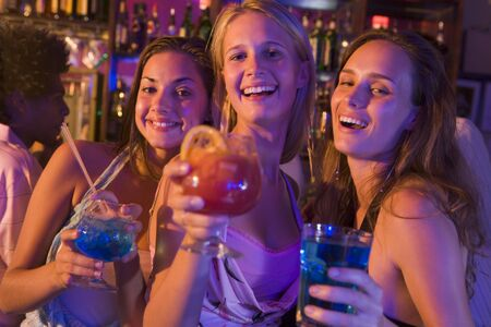 only teenage girls: Young women in a bar Stock Photo