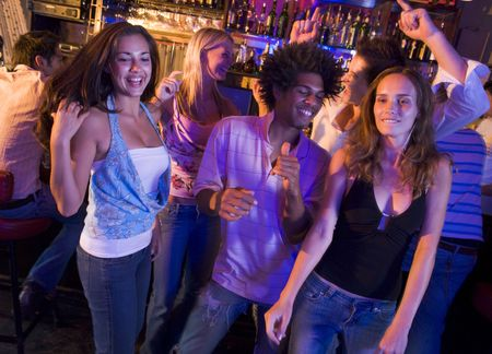 colored gels: Young people dancing in a bar