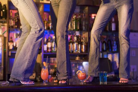 colored gels: Young people dancing on a bar counter