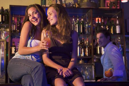 colored gels: Young women in a bar Stock Photo