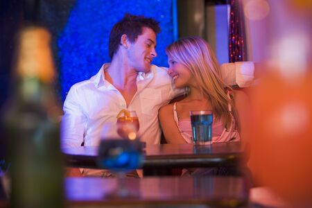 colored gels: Young couple in a bar