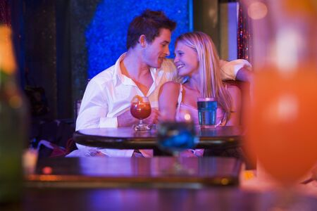 women having fun: Young couple in a bar