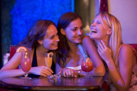 alcohol series: Young women in a bar Stock Photo