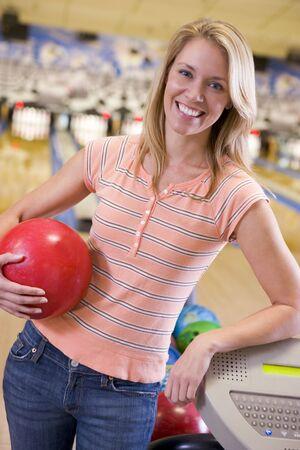 offset views: Woman at a bowling lane Stock Photo