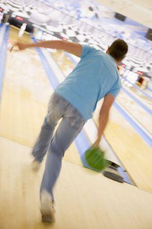 offset views: Man bowling
