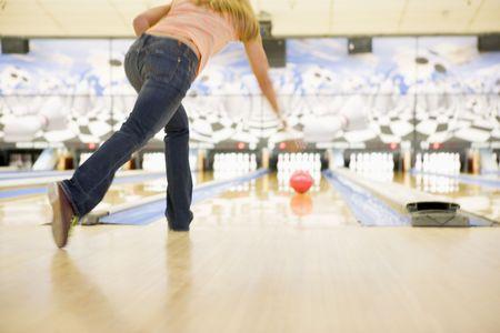 bowling alley: Woman bowling