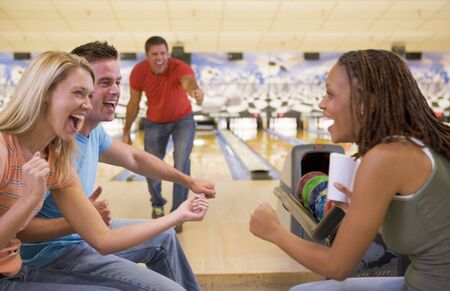 30s adult: Man bowling with friends