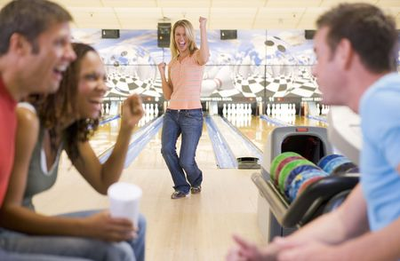 Woman bowling with friends photo