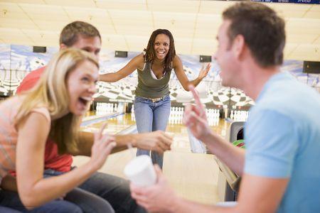 bowling strike: Woman bowling with friends