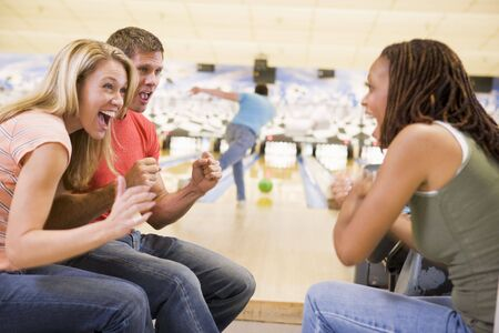 Man bowling with friends Stock Photo - 3207769
