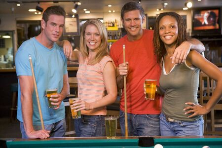 billiards cues: Friends at a pool hall