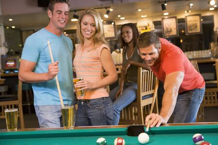 Friends playing pool photo